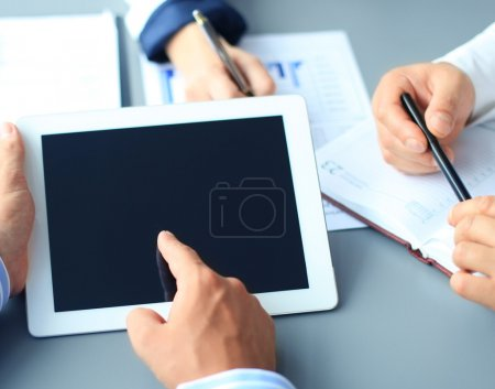 Photo for Business adviser analyzing financial figures denoting the progress in the work of the company - Royalty Free Image