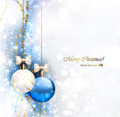 Blue Christmas background with two Christmas baubles