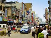 People walking on a street of Pettah neighborhood, Colombo, Sri
