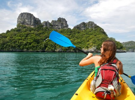 Young woman kayaking in Ang Thong National Marine Park, Thailand