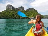 Young woman kayaking in Ang Thong National Marine Park, Thailand