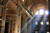 Interior of Saint Peters Basilica with crepuscular rays, Vatican