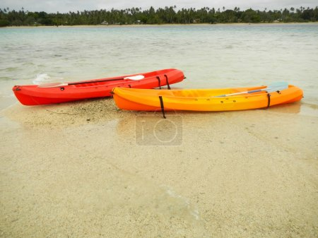 Colorful kayaks in a water, Ofu island, Tonga