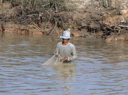 Fisherman on Tonle Sap Lake in Siem Reap, Cambodia