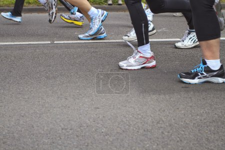 Detail of the legs of runners as they pass