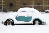 Snow coverd old timer car