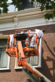Painter on aerial access platform