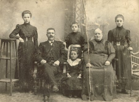A photo taking in the Russian Empire, shows a family of Russian Germans, man, woman and four children, Ust-Abakan sawmill, a veterinary