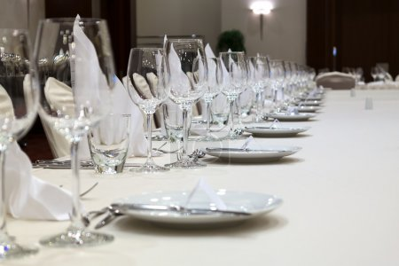 Fine table setting in gourmet restaurant (close-up). Focus in the center.