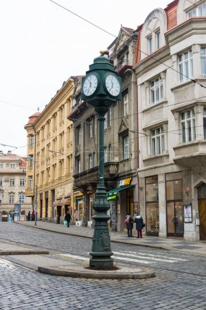The streets of old Prague. The town clock on the pole. Crossroads.