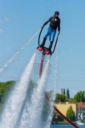 Demonstration performance at Flyboard. 2nd Berlin water sports festival in Gruenau.