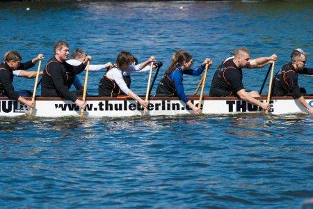 Rowers in a boat. 2nd Berlin water sports festival in Gruenau.