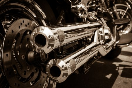 BERLIN, GERMANY - MAY 17, 2014: Exhausts of motorcycle Harley Davidson Softail. Rear view. Sepia. 27th Oldtimer Day Berlin - Brandenburg