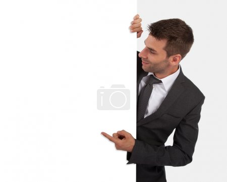 Businessman pointing at a blank board