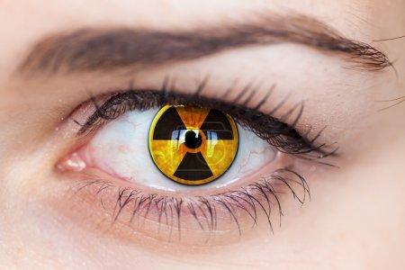 Human eye with radiation symbol.