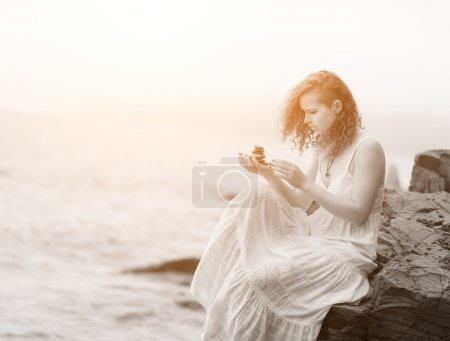 Portrait of woman holding zen stones.