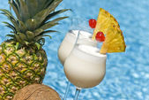 Pina Colada Cocktail by the Swimming Pool