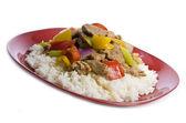 Stir Fried Pork Tenderloin and Vegetables on a Bed of Rice