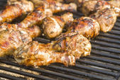 Barbecued Jerk Chicken drumsticks on the Grill