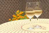 Two Glasses of White Wine on a Patio Table