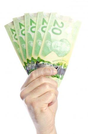 Photo pour Remise de bons du Trésor canadiens de 20 dollars . - image libre de droit