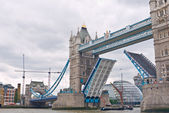Tower Bridge raises for The May a traditional Sail barge.