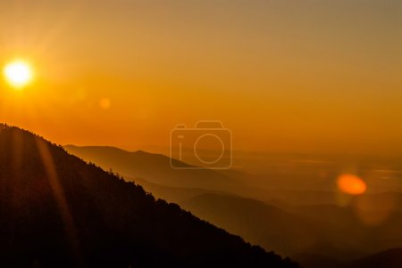 Sun rising over snowy mountains of Smokies in early spring with