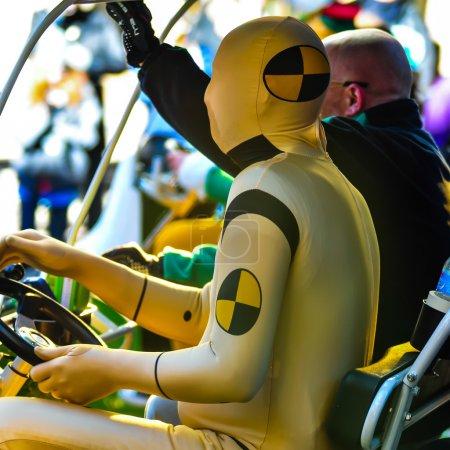 dummy driving a golf cart