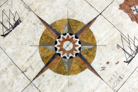 Detail of a wind rose in marble near the Monument to the portugu