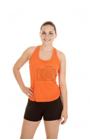 Photo for A woman with her hand on her hip with a smile on her lips in her fitness clothes. - Royalty Free Image