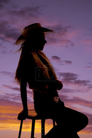 Woman on stool cowgirl sunset