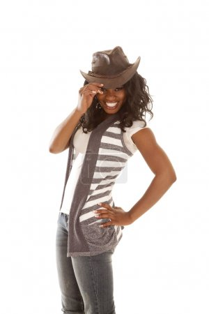 African cowgirl hold hat