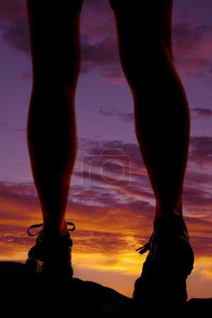 Woman legs walk sunset