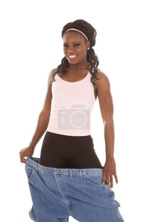 woman big pants happy