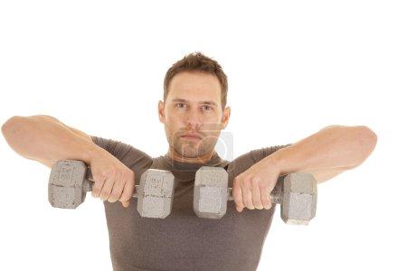 man lift weights gray shirt