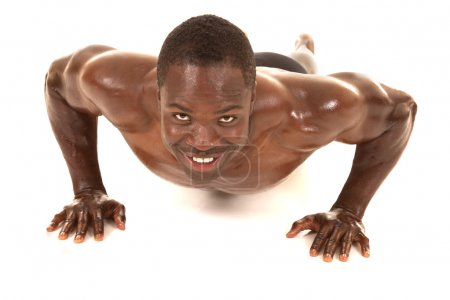 Photo for An African American man shirtless doing a pushup. - Royalty Free Image