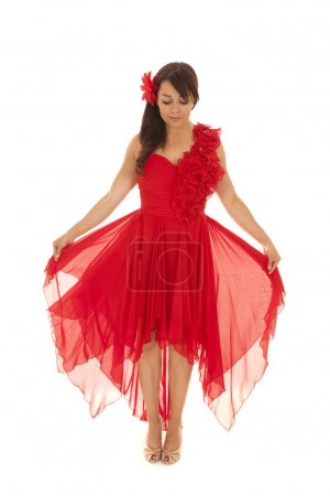woman in a red dress holds it out
