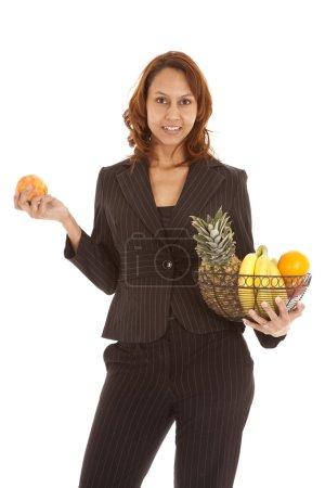 holding up fruit