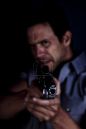 Mad man pointing gun
