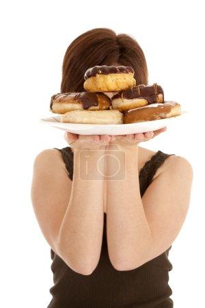 Hiding face behind doughnuts