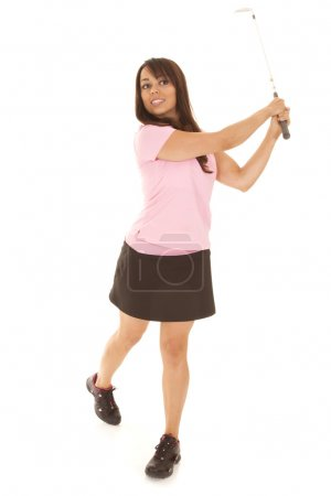 Woman golf pink shirt hold follow through