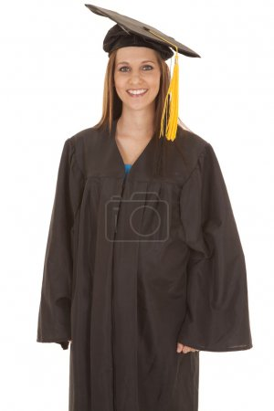 Photo for A woman standing in a graduation gown with a smile. - Royalty Free Image