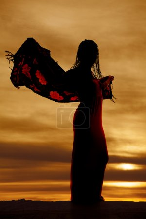 Woman silhouette blowing sarong