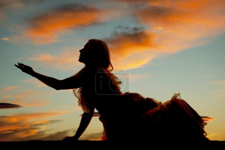 Silhouette woman sit big dress reach