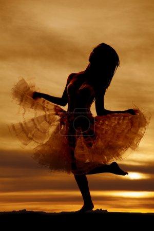 Silhouette woman white skirt kick up leg