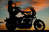 silhouette woman motorcycle heels up hand chin