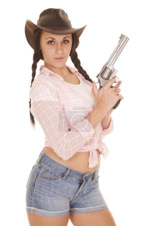 woman pink plaid shirt gun look serious