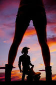 silhouete woman legs heels from back