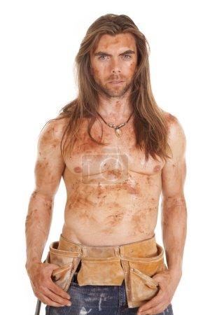 man no shirt dirty tool belt