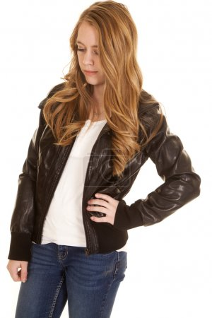 Woman in leather jacket looking down